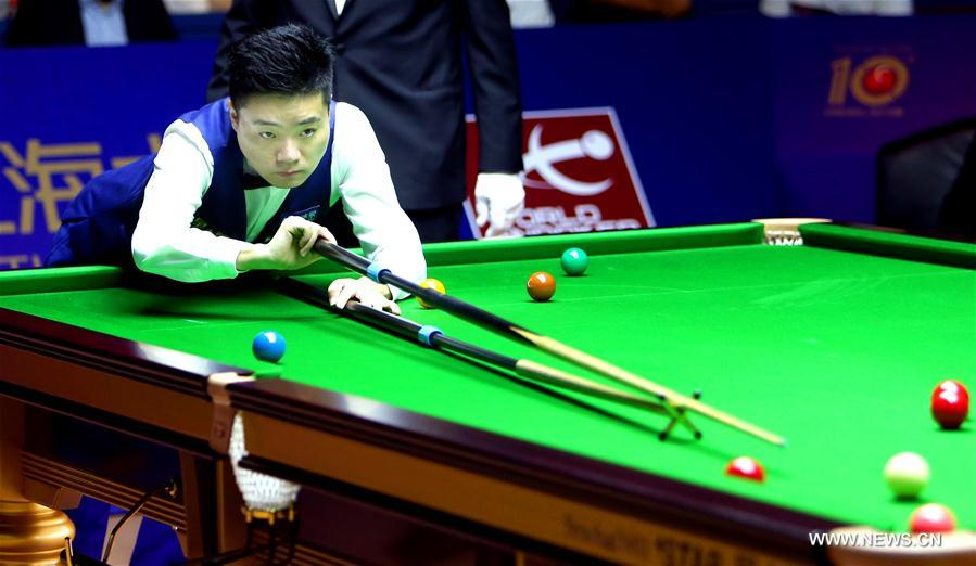 Ding Junhui of China plays a shot during a quarterfinal match against Michael Holt of England at the 2016 Shanghai Masters world snooker tournament in Shanghai, China, Sept. 23, 2016.
