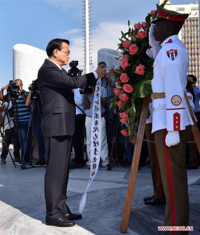 Chinese Premier Li Keqiang lays a wreath at the monument of Jose Julian Marti Perez and visited a local memorial hall in memory of the Cuban national hero in Havana on Sept. 24, 2016. Jose Julian Marti Perez, a great poet, national hero and thinker of Cuba, dedicated his short life to Cuba's independence and freedom in Latin America. He participated in revolutionary activities against colonization when he was 15 years old and died on the battlefield fighting for Cuba's independence at the age of 42. [Photo: Xinhua]
