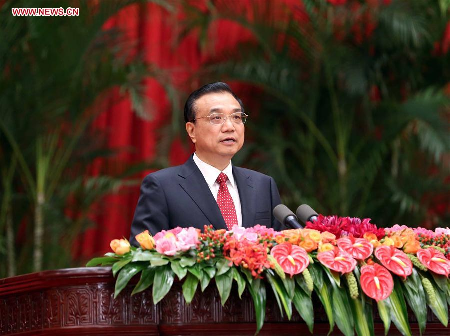 Chinese Premier Li Keqiang addresses a reception held by the State Council to celebrate the 67th anniversary of the founding of the People