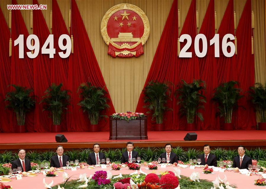 Chinese PresidentXi Jinping(C), PremierLi Keqiang(3rd L), and senior leadersZhang Dejiang(3rd R),Yu Zhengsheng(2nd L),Liu Yunshan(2nd R),Wang Qishan(1st L) andZhang Gaoli(1st R) attend a reception held by the State Council to celebrate the 67th anniversary of the founding of the People