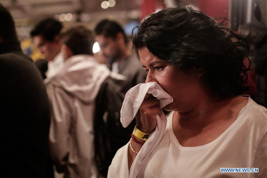 """A woman reacts after knowing the result of the vote for the peace agreement signed by the Colombian government and the Armed Revolutionary Forces of Colombia (FARC) at the headquarters of the """"yes"""", in Bogota, capital of Colombia, on Oct. 2, 2016. On Sunday, Colombians voted against historic peace deal with Armed Revolutionary Forces of Colombia (FARC). (Xinhua/Jhon Paz)"""