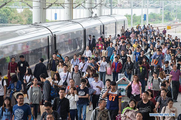 Passengers walk out of the Nanjing Railway Station in Nanjing, capital of East China