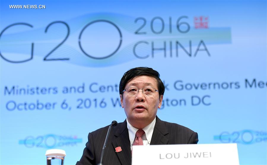 Chinese Finance Minister Lou Jiwei speaks at a press conference on G20 Finance Ministers and Central Bank Governors Meeting at the headquarters of International Monetary Fund(IMF) in Washington D.C., the United States, Oct. 7, 2016. Global economy continued to face uncertainty and rising risks, Lou Jiwei said on behalf of the G20 economies on Friday. (Xinhua/Yin Bogu)