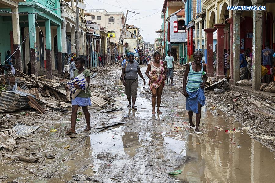 Image provided by the United Nations Stabilization Mission in Haiti shows villagers walking through a flooded street after the pass of Hurricane Matthew, in Jeremie city, Haiti on Oct. 6, 2016. Haiti was hit hardest by Hurricane Matthew in the Caribbean region with more than 271 people reported dead as of Thursday evening. (Xinhua/Logan Abassi/UN/MINUSTAH)