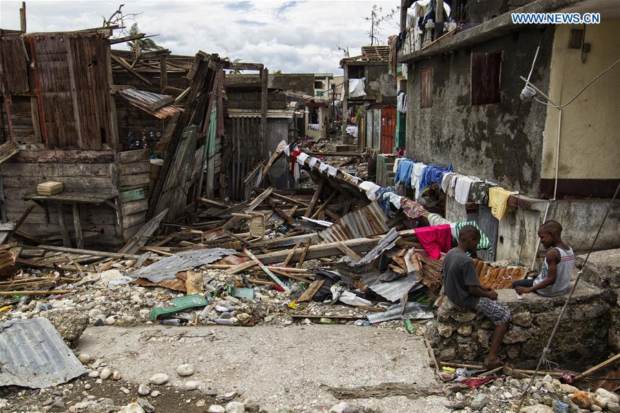 Image provided by the United Nations Stabilization Mission in Haiti shows two boys playing on the debris left by Hurricane Matthew in Jeremie city, Haiti on Oct. 6, 2016. Haiti was hit hardest by Hurricane Matthew in the Caribbean region with more than 271 people reported dead as of Thursday evening. (Xinhua/Logan Abassi/UN/MINUSTAH)