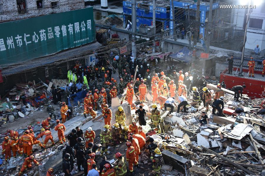 Rescuers work at the accident site after buildings collapsed in Wenzhou City, east China
