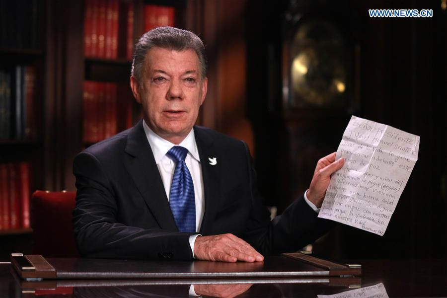Image provided by the Colombian Presidency shows Colombian President Juan Manuel Santos making a statement in Bogota, Colombia, Oct. 10, 2016. The Colombian government and the National Liberation Army (ELN), the country