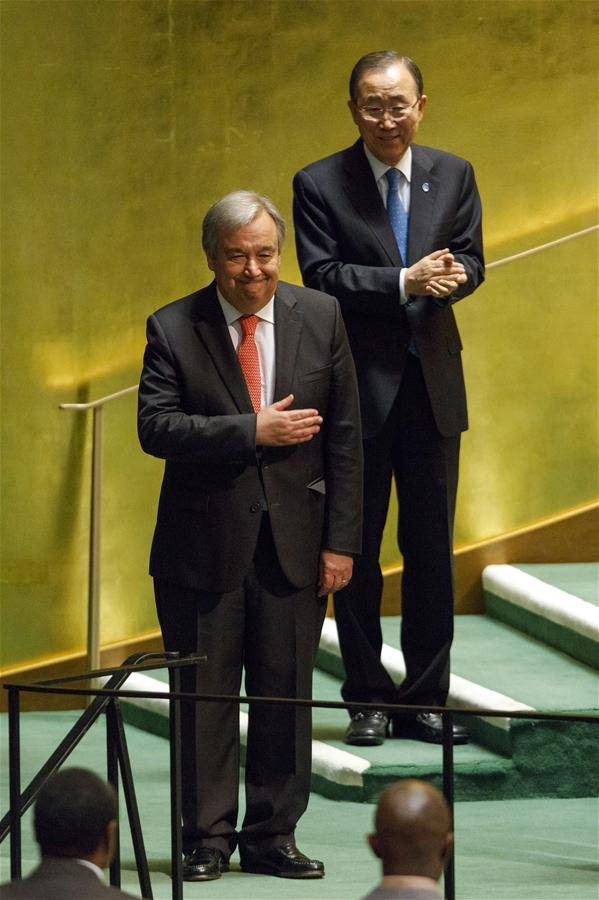 Antonio Guterres (front) gestures after he was appointed as the new UN Secretary-General at the UN headquarters in New York, Oct. 13, 2016. The United Nations General Assembly on Thursday appointed by acclamation Portuguese former Prime Minister Antonio Guterres as next UN secretary-general to succeed retiring Ban Ki-moon on Jan. 1, 2017. (Xinhua/Li Muzi)