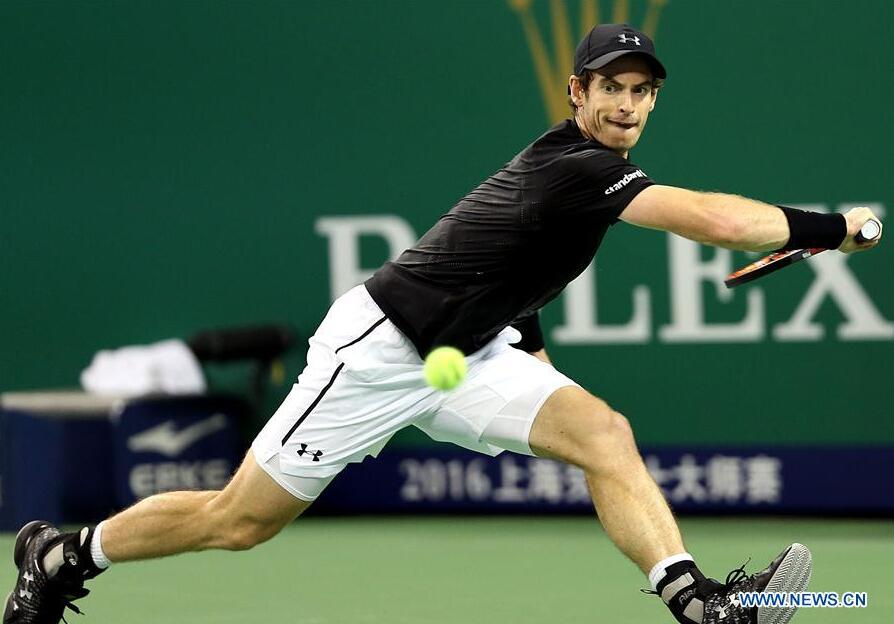 Andy Murray of Britain returns the ball during the men