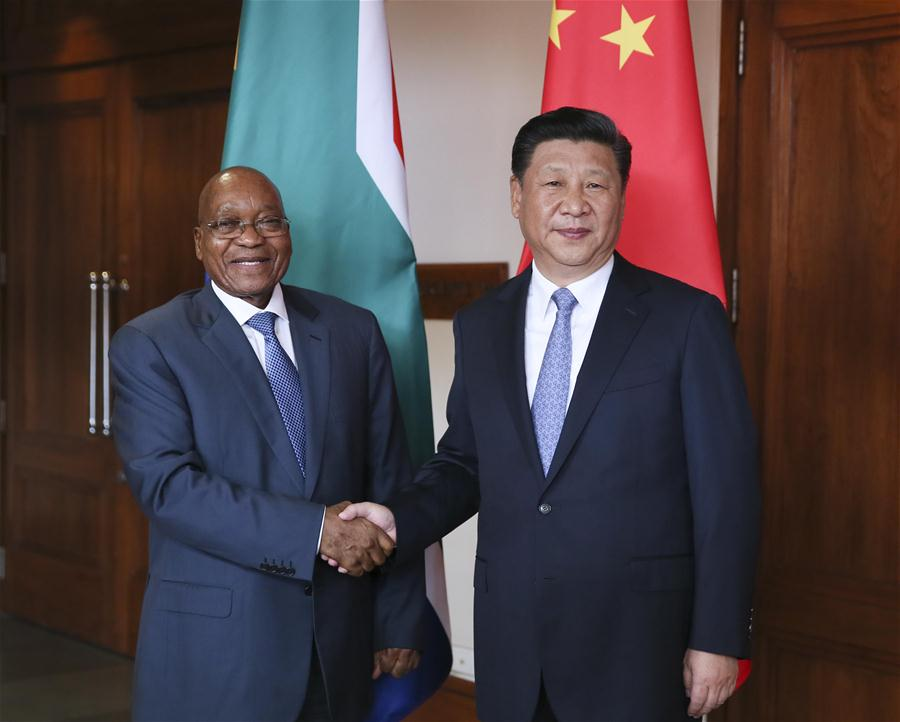 Chinese President Xi Jinping meets with South African President Jacob Zuma in the western Indian state of Goa, Oct. 15, 2016. (Xinhua/Lan Hongguang)