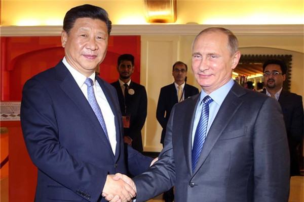 Chinese President Xi Jinping meets with Russian President Vladimir Putin in the western Indian state of Goa, Oct. 15, 2016.