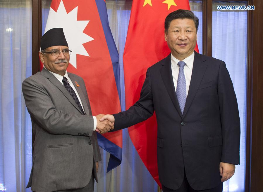 Chinese President Xi Jinping (R) meets with Nepali Prime Minister Pushpa Kamal Dahal in the western Indian state of Goa, Oct. 15, 2016.