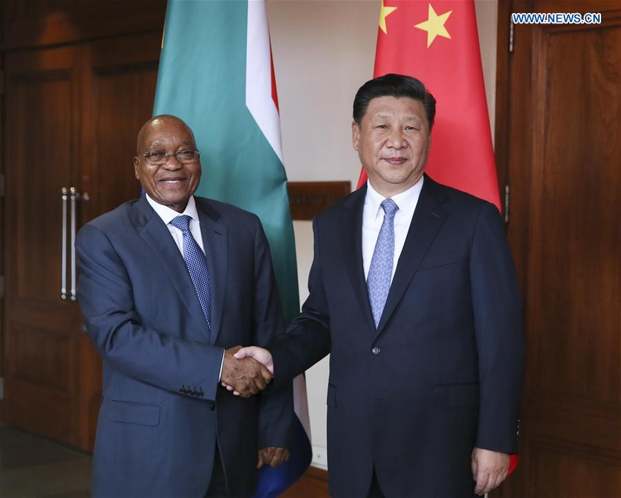 Chinese President Xi Jinping meets with South African President Jacob Zuma in the western Indian state of Goa, Oct. 15, 2016.