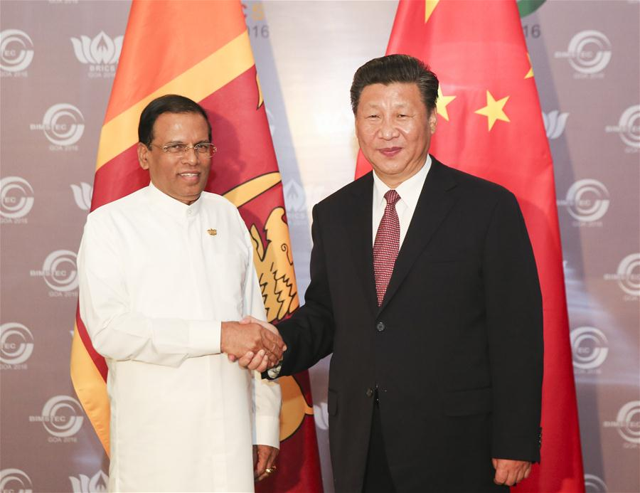 Chinese President Xi Jinping meets with Sri Lankan President Maithripala Sirisena in the western Indian state of Goa, Oct. 16, 2016. (Xinhua/Ding Lin)