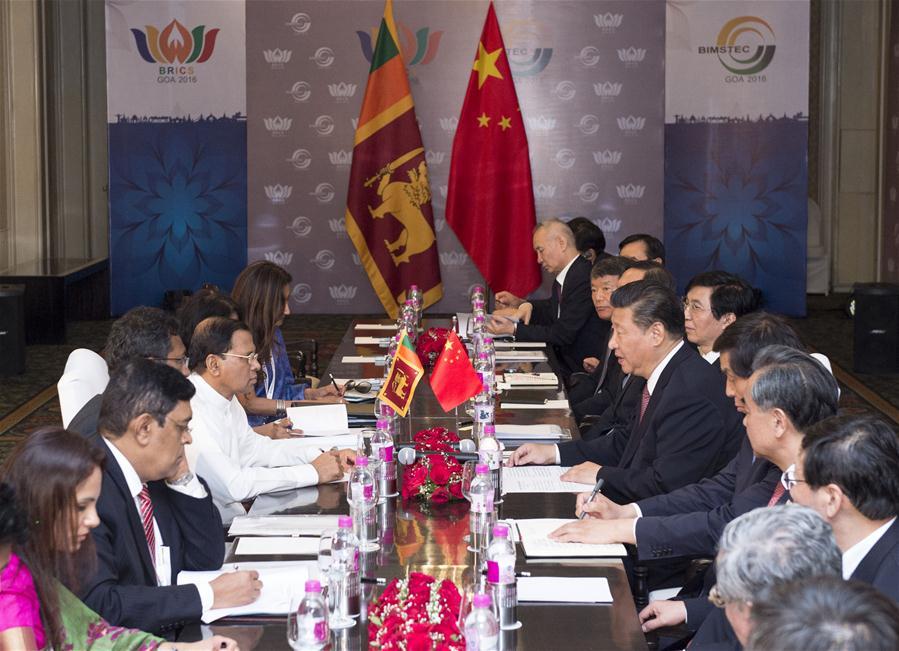 Chinese President Xi Jinping meets with Sri Lankan President Maithripala Sirisena in the western Indian state of Goa, Oct. 16, 2016. (Xinhua/Wang Ye)