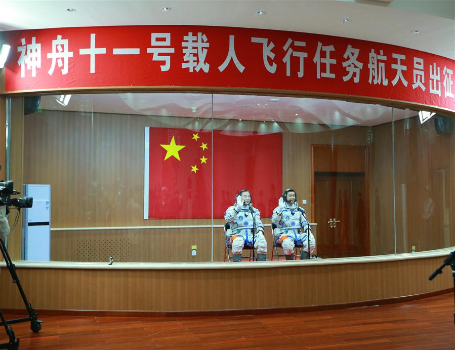 Taikonauts Jing Haipeng (L) and Chen Dong attend the see-off ceremony of the manned Shenzhou-11 mission at the Jiuquan Satellite Launch Center in Jiuquan, northwest China