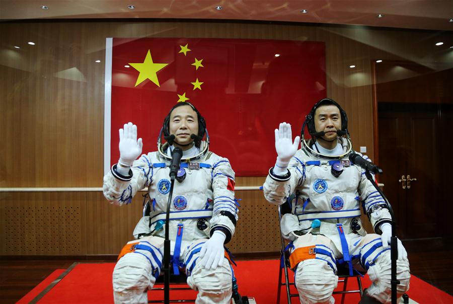 Taikonauts Jing Haipeng (L) and Chen Dong attend the see-off ceremony of the Shenzhou-11 manned space mission at the Jiuquan Satellite Launch Center in Jiuquan, northwest China