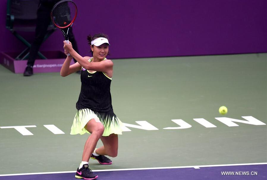 Peng Shuai of China returns the ball during the women