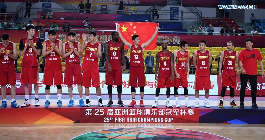 Players of China Xinjiang Kashgar react on the podium during the awarding ceremony at the 25th FIBA Asia Champions Cup in Chenzhou, central China