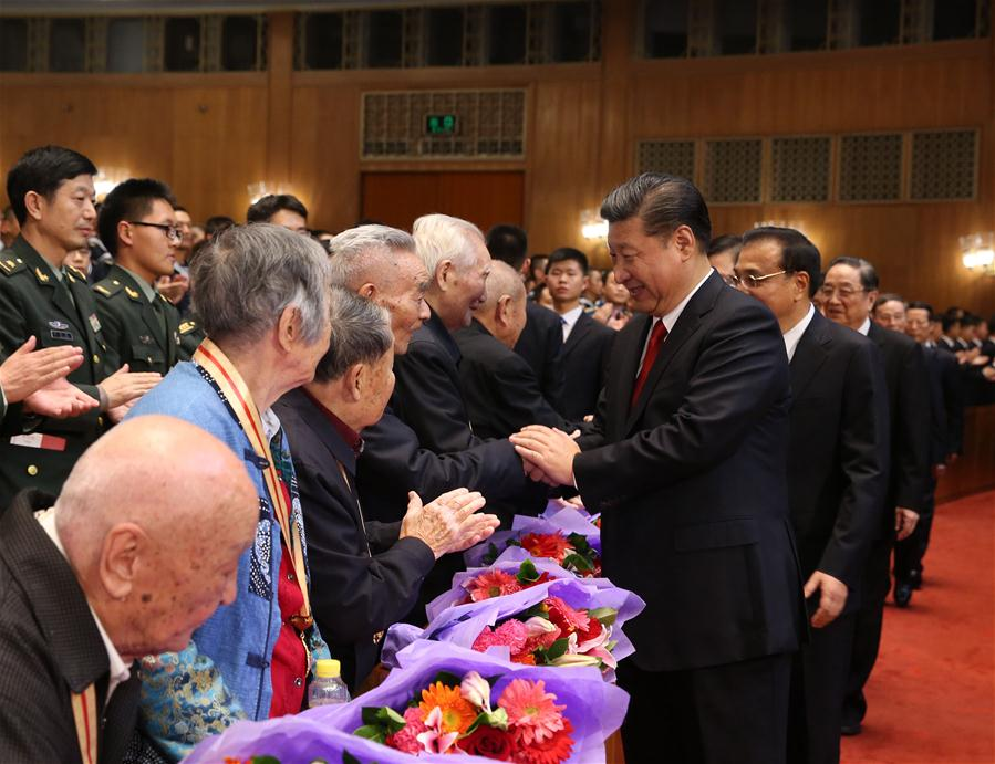 Chinese President Xi Jinping (front, R) shake hands with old veterans of the Red Army before watching a gala commemorating the 80th anniversary of the victory of the Long March in Beijing, capital of China, Oct. 19, 2016. Xi Jinping and other senior leaders Li Keqiang, Zhang Dejiang, Yu Zhengsheng, Liu Yunshan, Wang Qishan and Zhang Gaoli watched the gala in Beijing on Wednesday. (Xinhua/Ma Zhancheng)