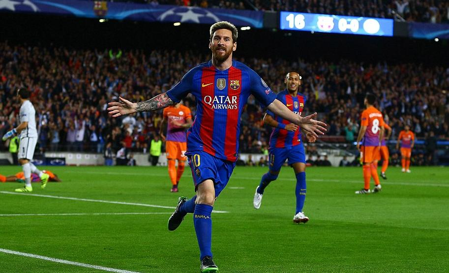 Lionel Messi wheels away in celebration after netting for Barcelona against Manchester City in the first half.