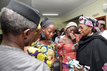 Some of the 21 Chibok school girls released are seen during a meeting with Nigeria