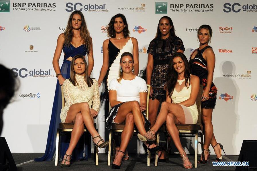 (L to R, rear) Karolina Pliskova of Czech Republic, Garbine Muguruza of Spain, Madison Keys of the United States, Dominika Cibulkova of Slovakia, (L to R, front) Simona Halep of Romania, Angelique Kerber of Germany, Agnieszka Radwanska of Poland pose during WTA Finals singles draw ceremony at the Marina Bay Sands in Singapore, Oct. 21, 2016. The WTA Finals 2016 will be held in Singapore on Oct. 23 to 30. (Xinhua/Then Chih Wey)