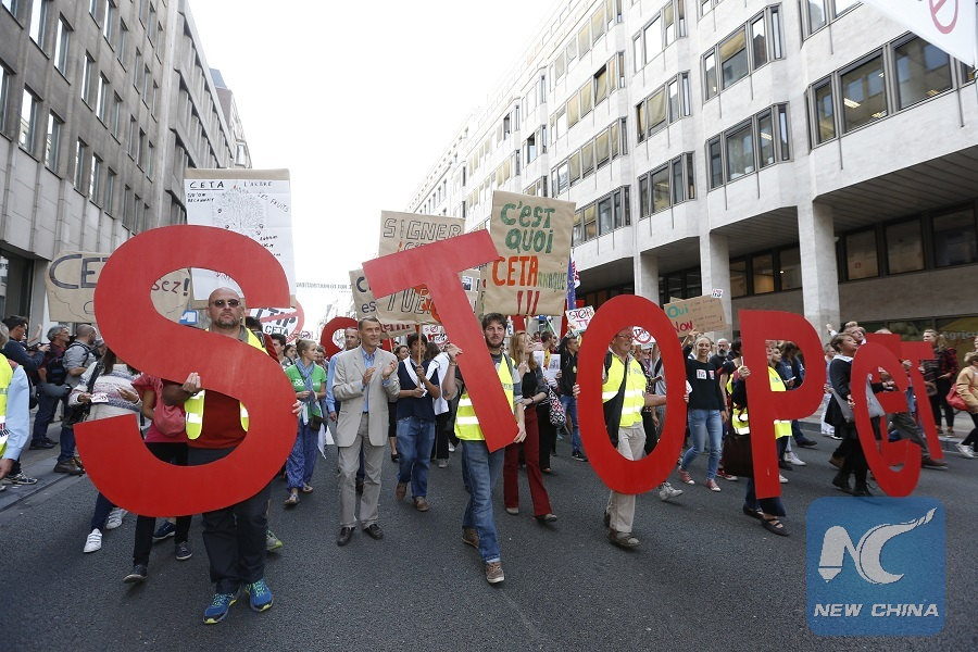 Protesters walk on a main avenue towards the European Union (EU) headquarters during a demonstration against the EU-U.S. Transatlantic Trade and Investment Partnership (TTIP) and the Comprehensive Economic and Trade Agreement (CETA) with Canada, in Brussels, capital of Belgium, Sept. 20, 2016. (Xinhua/Ye Pingfan)