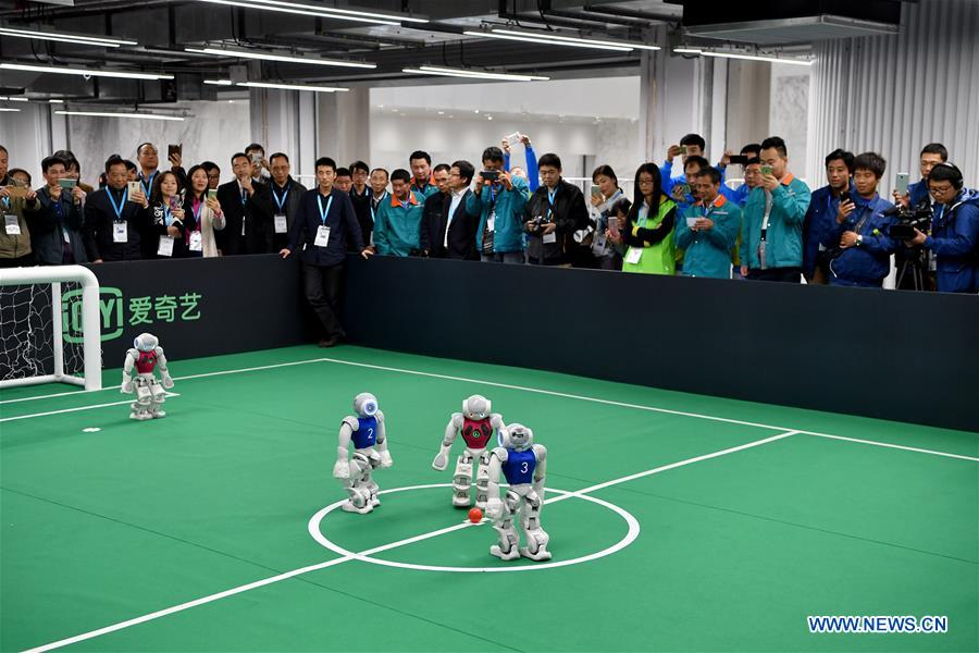 robots playing football during the 2016 World Robot Conference