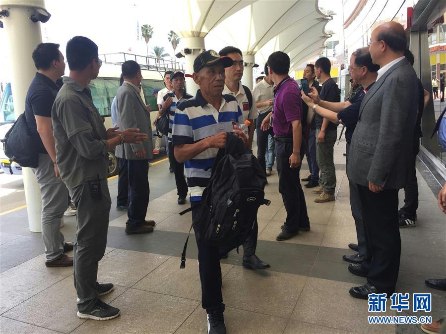 One of the Chinese sailors arrives at Kenyatta International Airport in Nairobi, Kenya, on Sunday. Nine out of the ten Chinese crew members freed by Somali pirates took a flight home on Monday from the Kenyan capital Nairobi, accompanied by officials sent from Beijing. (Photo/Xinhua)