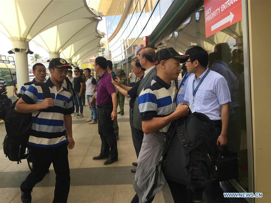 Chinese crew members (wearing caps) freed by Somali pirates arrive at the airport before heading home, in Nairobi, Kenya, Oct. 24, 2016. Nine out of the ten Chinese crew members freed by Somali pirates took a flight home on Monday from the Kenyan capital Nairobi, accompanied by officials sent from Beijing. (Xinhua/Sun Ruibo)
