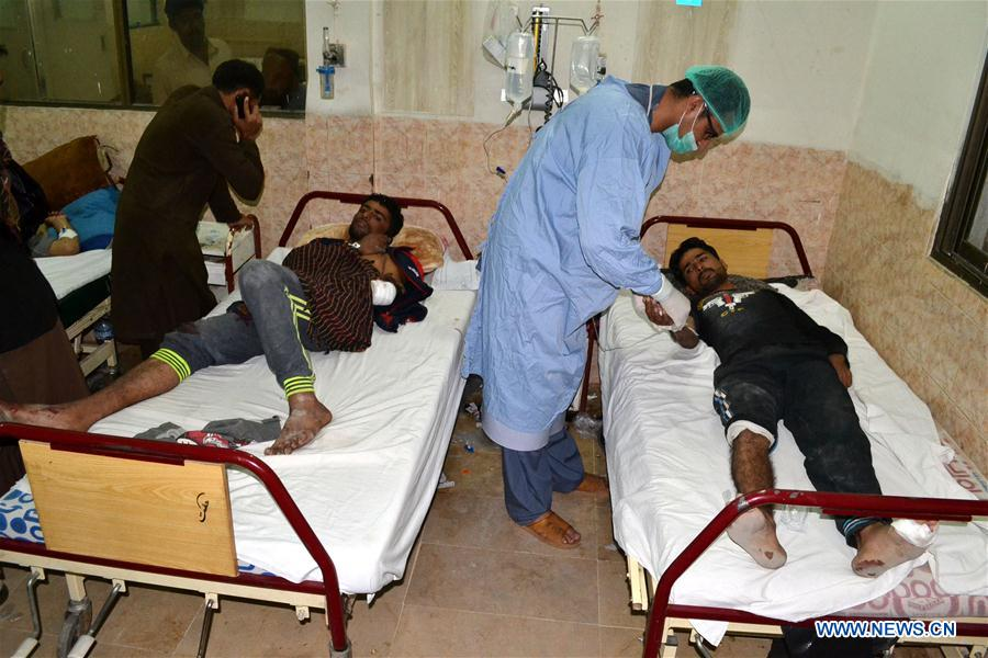 Injured personnel receive medical treatment at a hospital in southwest Pakistan