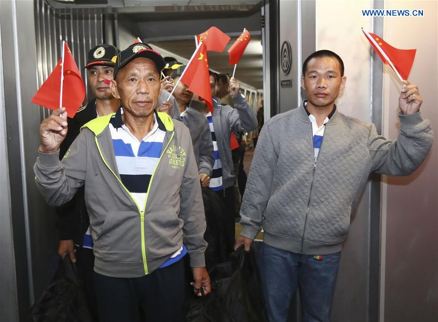 Rescued Chinese crew members held captive by Somali pirates for years arrive at Baiyun International Airport in Guangzhou, capital of south China