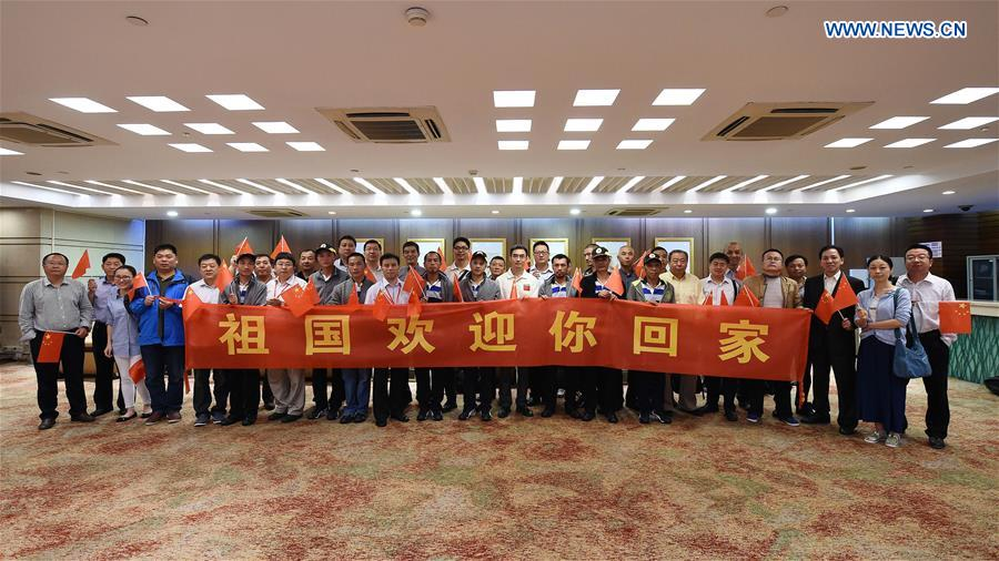 Rescued Chinese people held captive by Somali pirates for years are welcomed upon their arrival at Baiyun International Airport in Guangzhou, south China