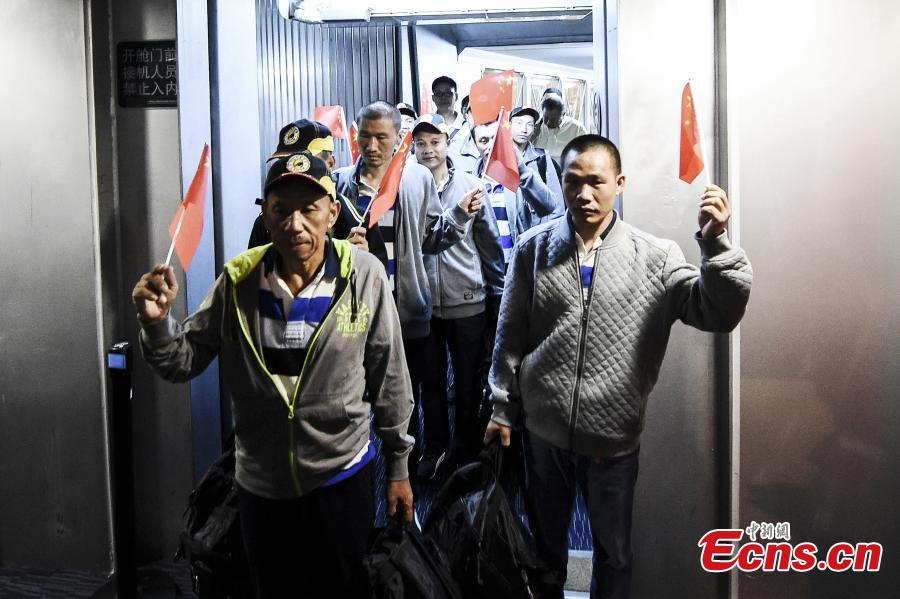Chinese sailors released after being held captive by Somalia pirates for more than four years arrive at an airport in Guangzhou City, South China's Guangdong Province, Oct. 25, 2016. One sailor continues to receive treatment in Kenya and the other nine returned to China on Tuesday. [Photo: China News Service]