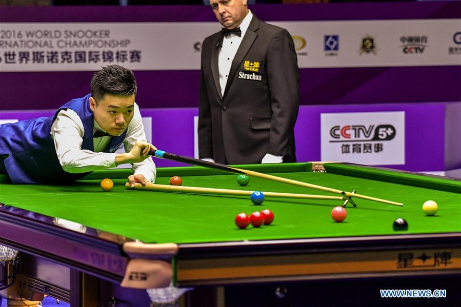 Ding Junhui of China plays a shot during the quarterfinal match against John Higgins of Scotland at the 2016 World Snooker International Championship in Daqing, northeast China