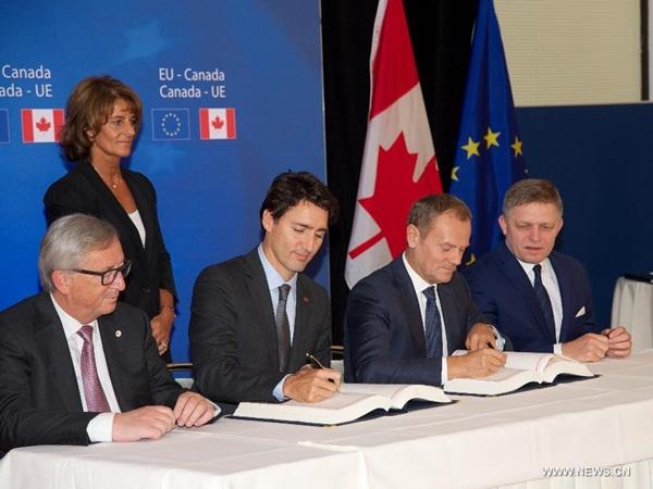 كندا توقع اتفاقا للتجارة الحرة مع الاتحاد الأوروبي