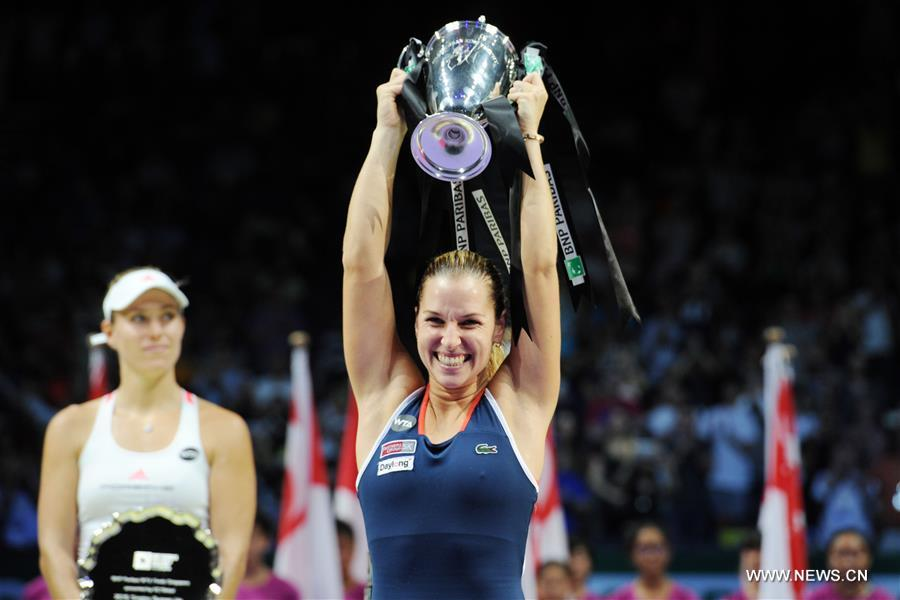 Dominika Cibulkova of Slovakia holds the trophy during the victory ceremony after winning the WTA Finals match against Angelique Kerber of Germany at Singapore Indoor Stadium, Oct. 30, 2016. Cibulkova won 2-0. (Xinhua/Then Chih Wey)