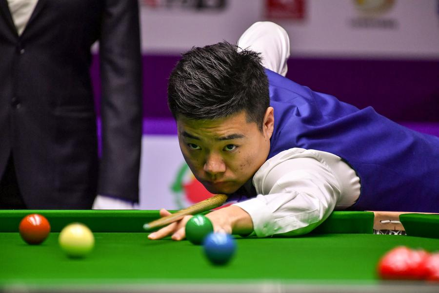 Ding Junhui of China plays a shot against Mark Selby of England in their final match during the World Snooker International Championship 2016 in Daqing city, Northeast China