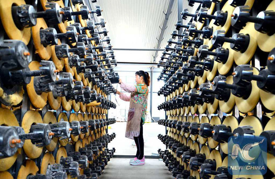 A worker works at a medical plastic factory in Yiyuan County, east China
