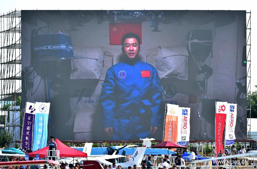 Photo taken on Nov. 1, 2016 shows a screen broadcasting Chinese astronaut Chen Dong sends his best wishes from the space lab Tiangong-2 to the on-going 11th China International Aviation and Aerospace Exhibition in Zhuhai, south China