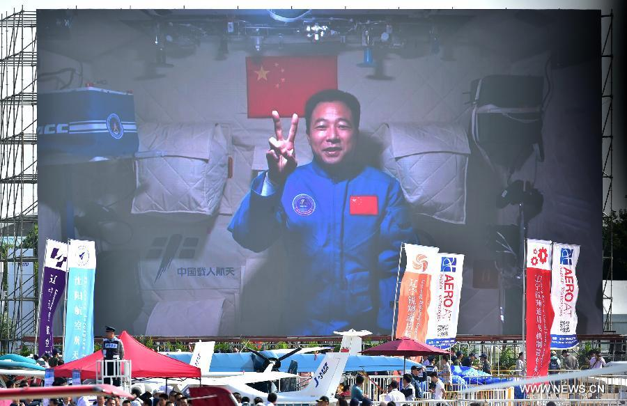 Photo taken on Nov. 1, 2016 shows a screen broadcasting Chinese astronaut Jing Haipeng sends his best wishes from the space lab Tiangong-2 to the on-going11th China International Aviation and Aerospace Exhibition in Zhuhai, south China