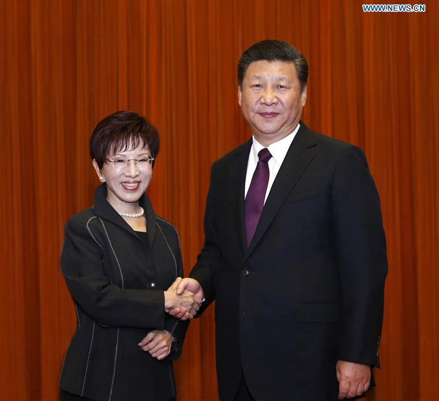 Xi Jinping (R), general secretary of the Communist Party of China Central Committee, meets with a delegation led by Hung Hsiu-chu, leader of Taiwan