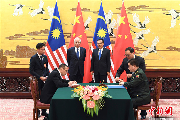 China, Malaysia sign infrastructure, defense deals