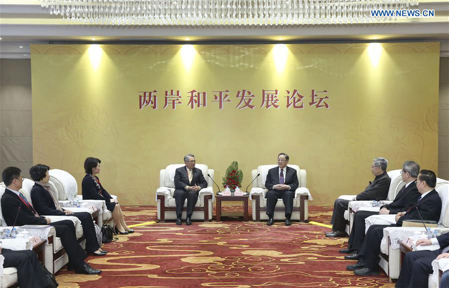 Yu Zhengsheng (R, rear), chairman of the National Committee of the Chinese People