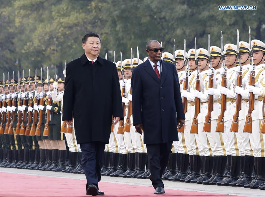 Chinese President Xi Jinping (L) holds a welcoming ceremony for visiting Guinean President Alpha Conde (R) before their talks in Beijing, capital of China, Nov. 2, 2016. (Xinhua/Ding Lin)