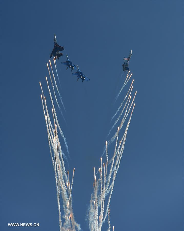 An aerobatic team from Russia perform at the 11th China International Aviation and Aerospace Exhibition in Zhuhai, south China