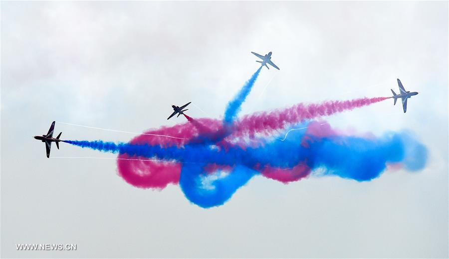 The Red Arrows, the British Royal Air Force Aerobatic Team, perform at the 11th China International Aviation and Aerospace Exhibition in Zhuhai, south China