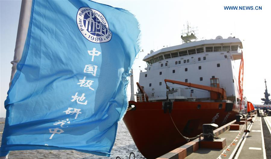 Team members of research vessel and icebreaker Xuelong (Snow Dragon) say goodbye at a Shanghai dock, east China, Nov. 2, 2016. China launched its 33rd Antarctic expedition when Xuelong left a Shanghai dock Wednesday morning. (Xinhua/Fang Zhe)