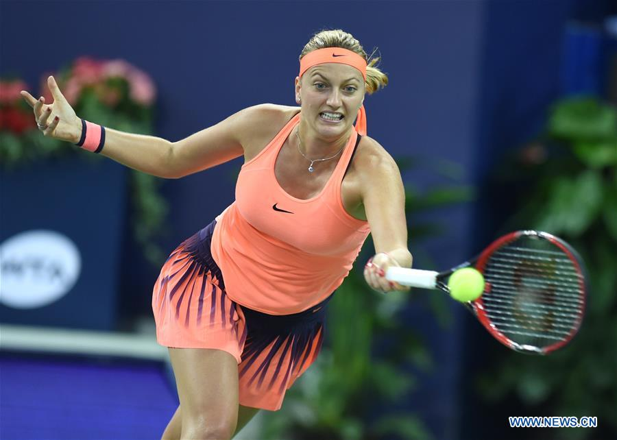 Petra Kvitova of the Czech Republic hits a return during the singles first round match against Roberta Vinci of Italy at the WTA Elite Trophy tournament in Zhuhai, south China